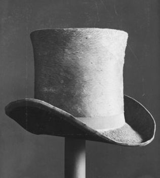 A hat from the 1830s, nothing to do with Holwell, but since I have not found one with his name on, this anonymous one will have to do (Source: Victoria & Albert Museum Images)